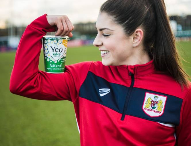 Football player Carla Humphries of Bristol City Women holding yeo valley organic natural yogurt pot