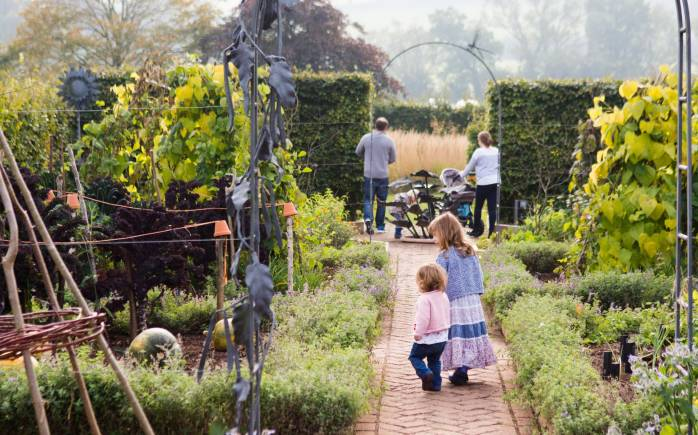 Family with children visit the Yeo Valley Organic Garden