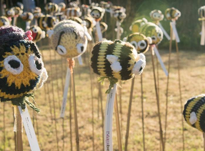 knitted bees in the organic garden for summer 2018