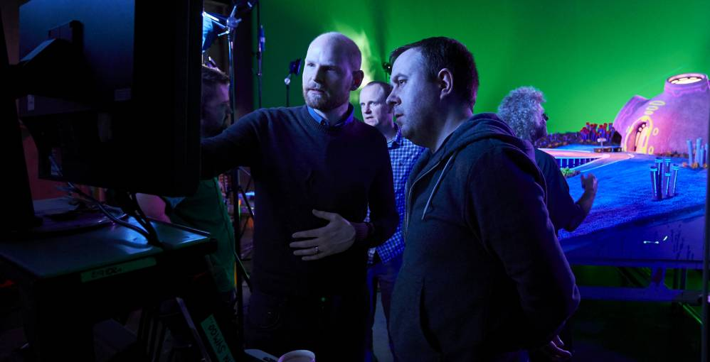 Directors Richard Phelan and Will Becher briefing on set.