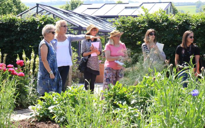Yeo Valley Organic HEad Gardener Andi giving a personal tour of the garden to a small group