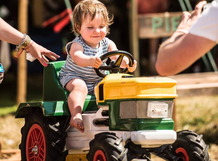 baby riding a tractor toy at ValleyFest